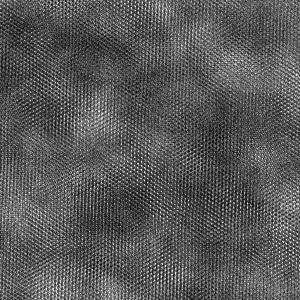 A black and white metallic looking cloud. Micrograph of atoms in quartz