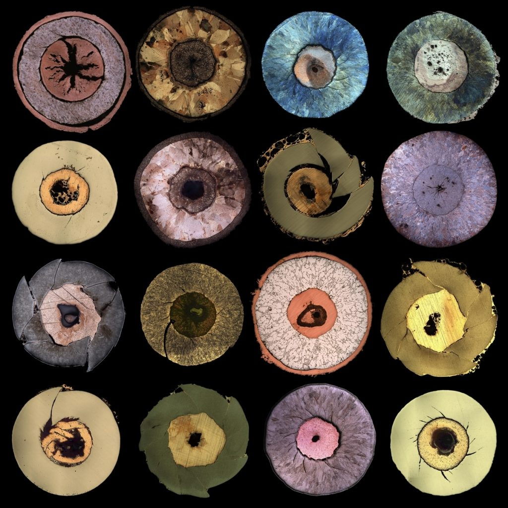 Colourful circles on a black background. Fossils: Electromagnetic collapse of metallic cylinders