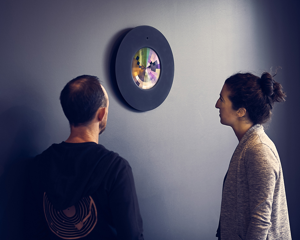 Two people look at Colourfield Lux, puzzled and interested