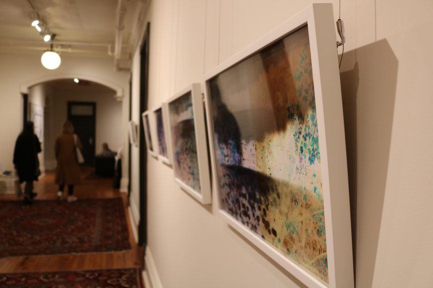 A series of photographs hanging in a hallway