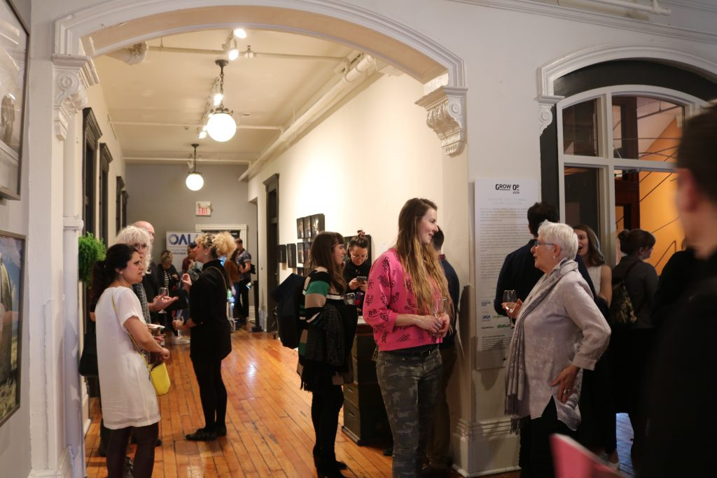 People looking and walking through a gallery