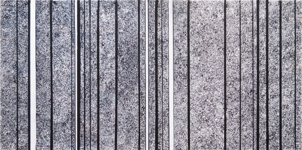 Black and vertical white lines on a grey panel