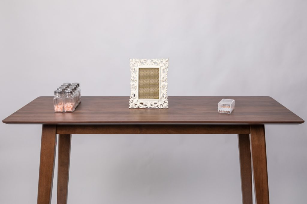 sciart: a table with salt, cigarettes, and a picture frame