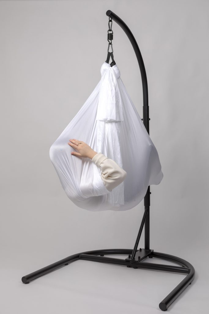 sciart: a person dangling in a white sheet