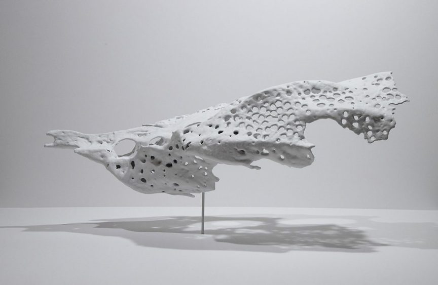 science art sculpture: a white fragment suspended in the air