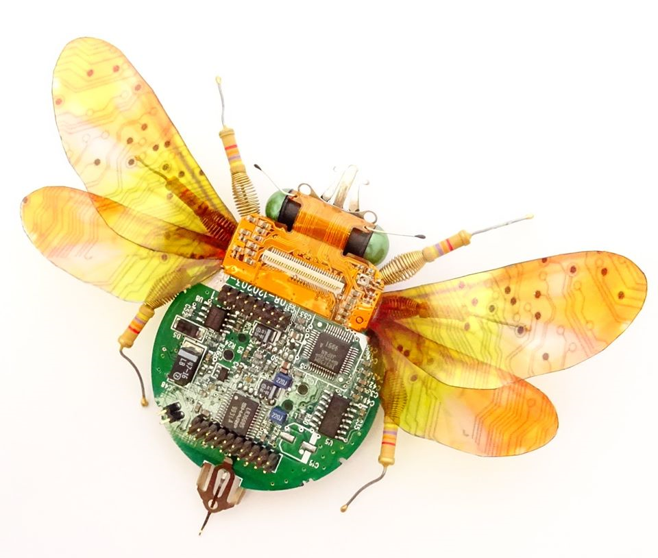 Bumble bee with the body made of a circuit board and other computer components.