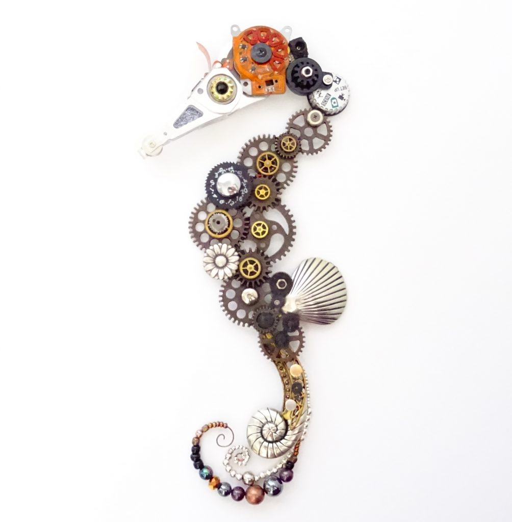 Seahorse made out of beads, gears, and other metal objects.