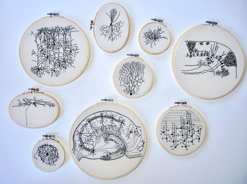 Multiple embroidery pieces of different neurons in black that are part of Stitching Hew's 100 Neuron Project.