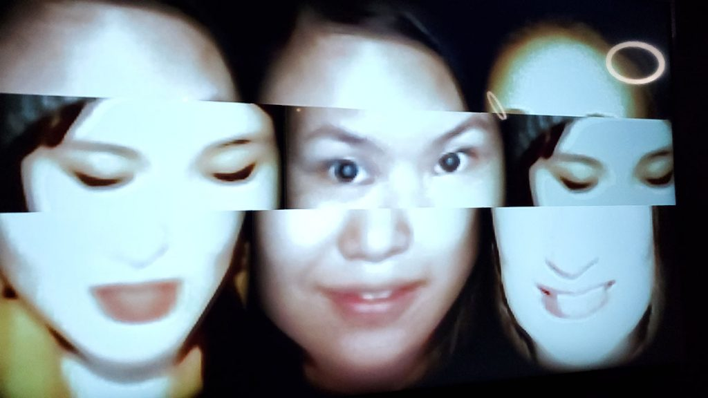 Three faces shown side by side with a strip encompassing the eyes of all faces. The strip is slightly off so that the middle portion of the faces are not matched with the rest of the faces.