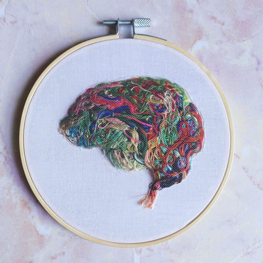 Brain made of scrap thread encompassed by thin mesh