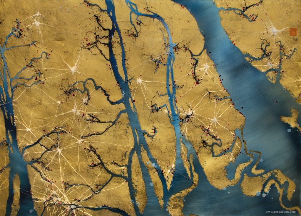 Landscape that looks like an aerial view of a river system. There are winding blue rivers among the golden land.