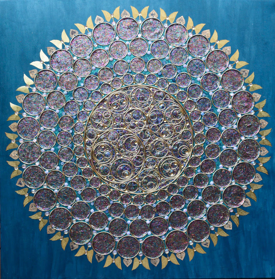 Dark, glittering circles radiating outward in a form that looks like the sun.