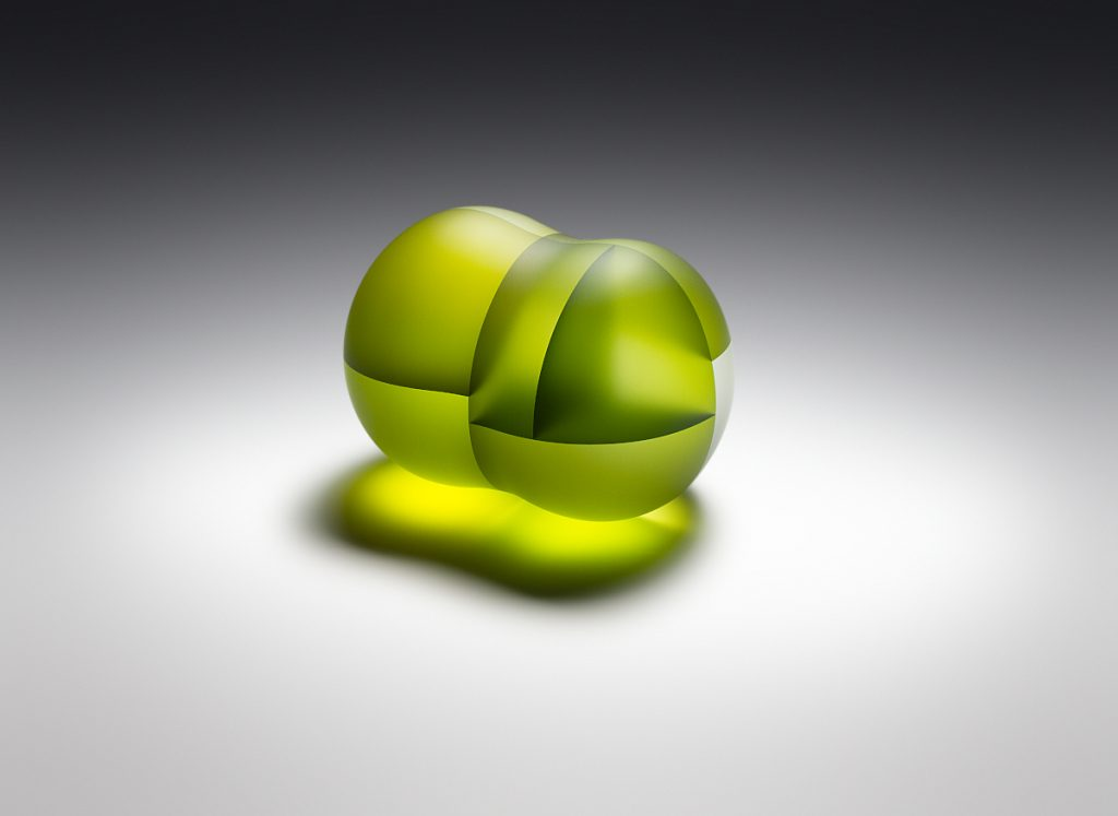 Translucent green glass structure that resembles two cells in division, displayed on a white background