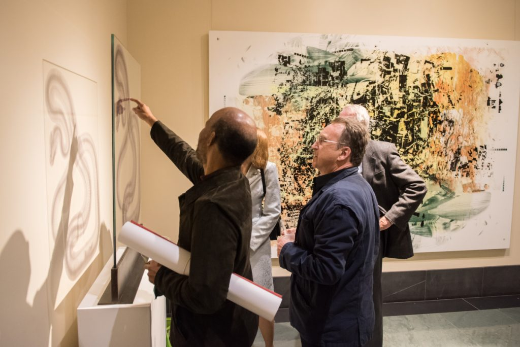 Four individuals looking at an exhibition