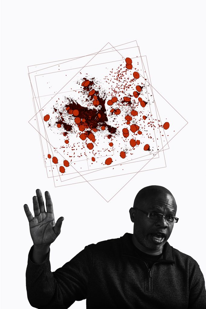 Portrait of a man speaking with his hand raised in front of a white background with red 3-dimensional cells.