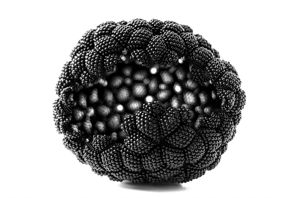 Black sphere made of joined beaded diamond shapes. Jagged hole in one side.