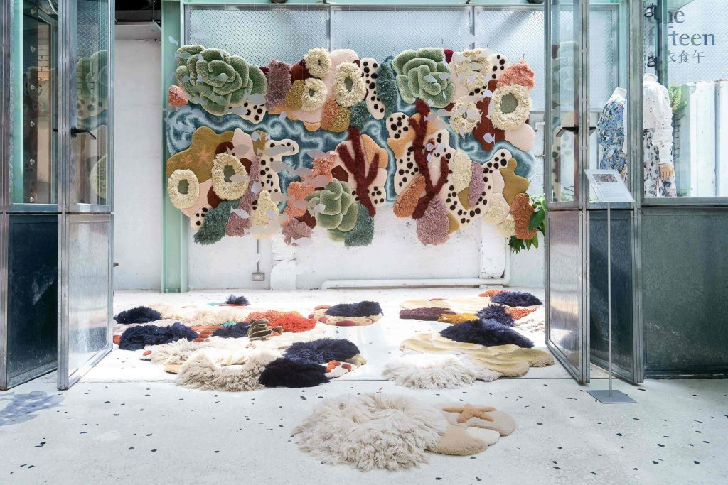 Large, colorful hanging tapestry in a display.