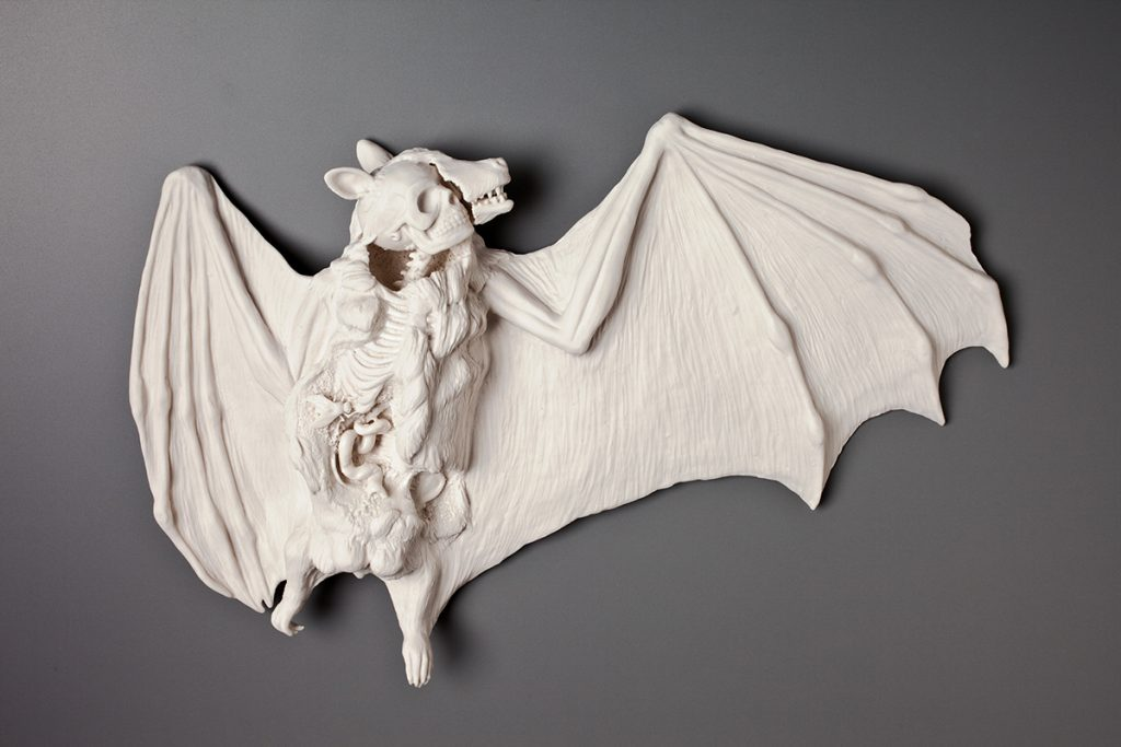 Bat with open body revealing a human skeleton