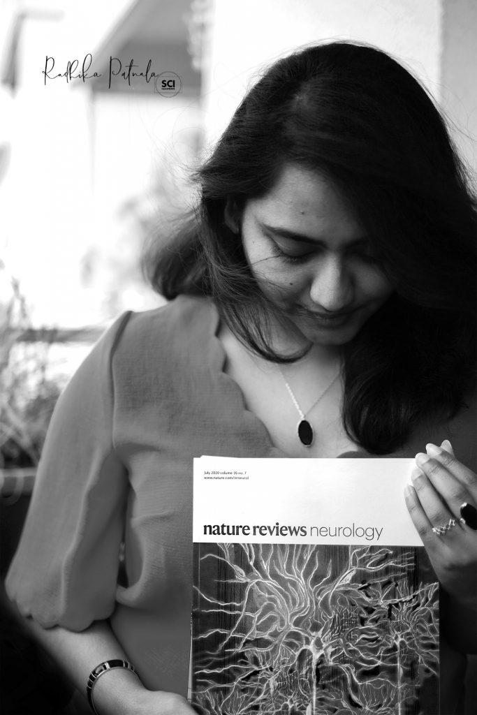Dr Radhika Patnala holding her Nature journal.