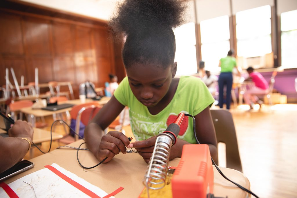 Girl working with circuits