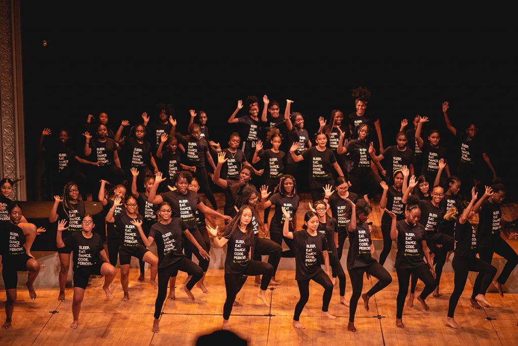 Girls dancing on stage wearing all black