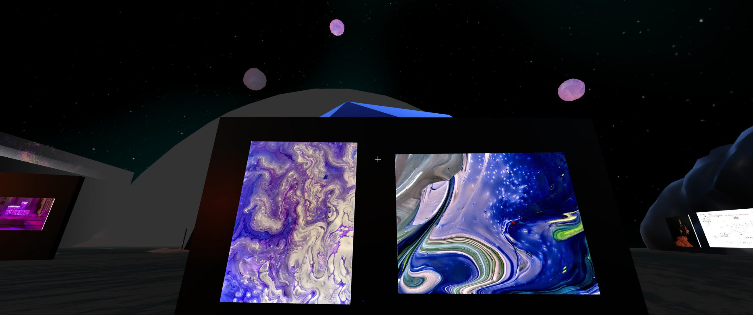 A black wall with two images. The images show purple, paint- or cloud-like swirls, mixed with greens, blues, and lighter colours.
