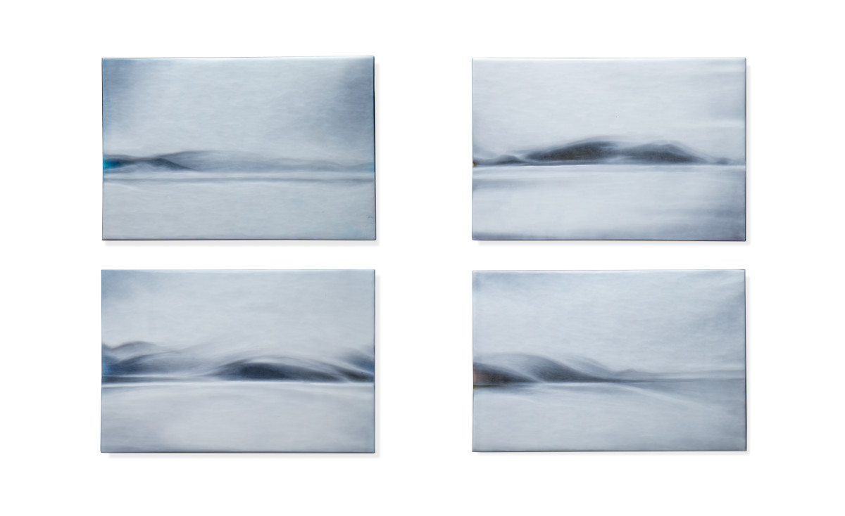 A series of four black and white images showing hill-like landscapes.