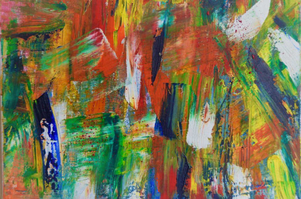 Many crisscrossing brushstrokes of bold green, blue, orange, yellow, and white.