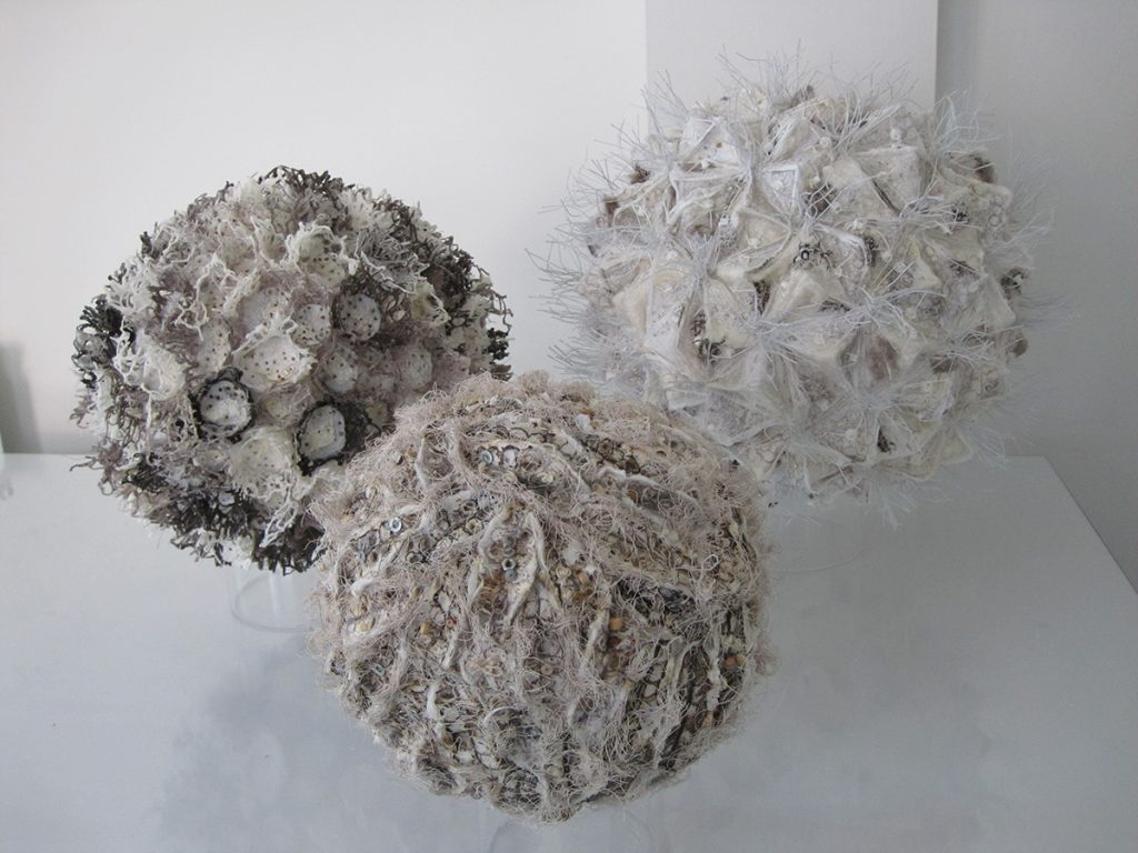 Three spheres with covered with fabrics to create different textures