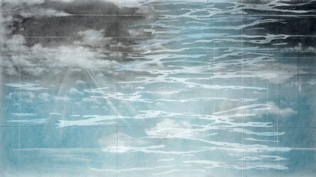 Surface of a blue ocean reflecting a gray sky with clouds.